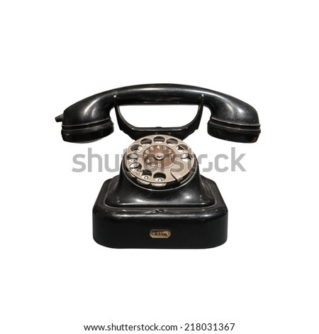 old black phone isolated on white - stock photo