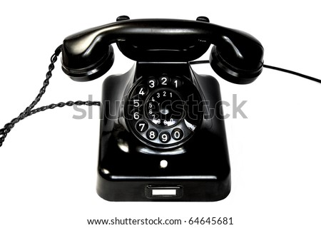 Old black rotary phone - stock photo