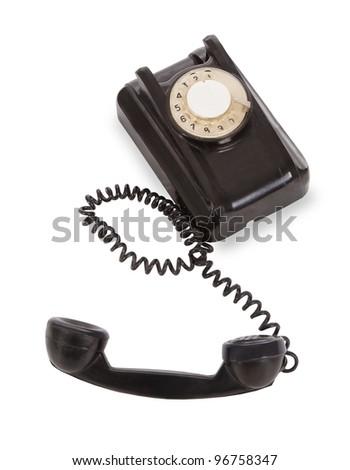 Old black telephobe isolated over white background - stock photo