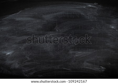 Old blackboard surface useful as education background or texture - stock photo