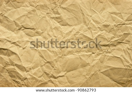 Old blank crumpled paper in yellow tone - stock photo