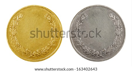 Old blank gold and silver coins isolated on white - stock photo