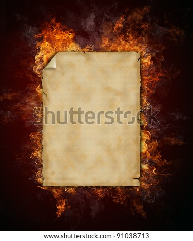 Old blank paper in flames - stock photo