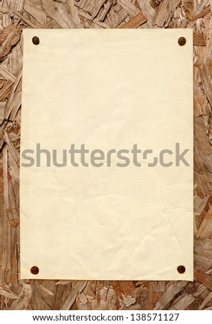 Old blank paper sign on outdoor noticeboard. - stock photo