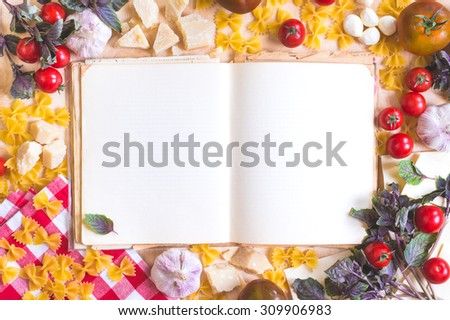 Old blank recipe book with italian food ingredients over rustic wooden table. Retro  - stock photo