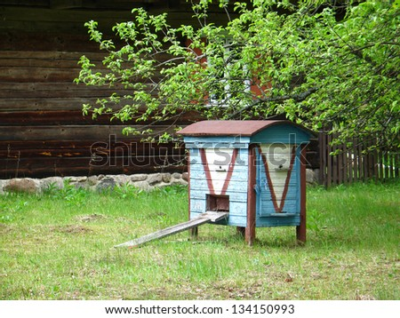 Old blue hive in the garden in Lithuania - stock photo