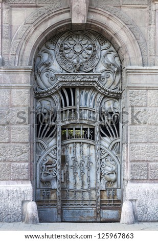 old blue iron entrance door with carving and iron textures - stock photo