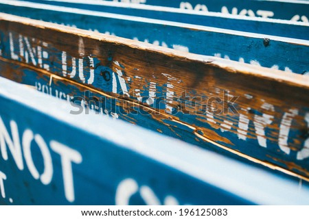 Old Blue Police Do Not Cross Barricades Stacked - stock photo