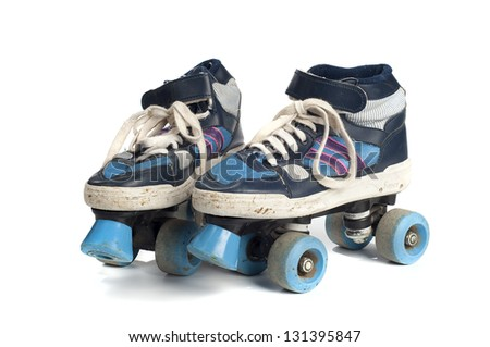old blue rollerblades isolated on white background - stock photo