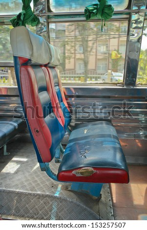 Old blue seat on bus - stock photo