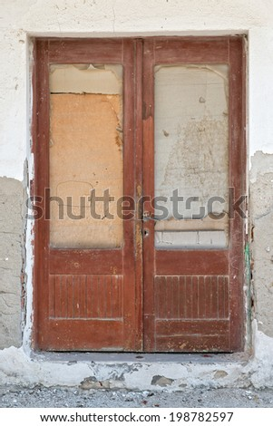 Old boarded up wooden door - stock photo