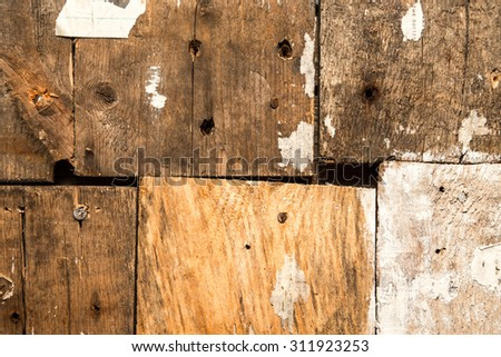 Old boards in an old house with the remains of old newspapers. Selected focus - stock photo