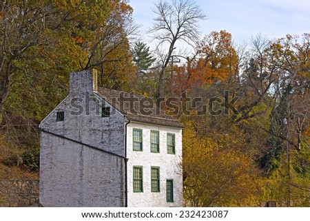 Old Boat House on the Potomac River and the Canal National Historic Park. The historic boat house in autumn, Washington DC, USA - stock photo