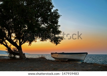 Old boat on the beach. - stock photo