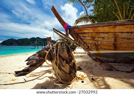Old Boat on the white sand tropical beach. Andaman sea. Province Krabi. Koh Phi Phi island. Kingdom Thailand - stock photo