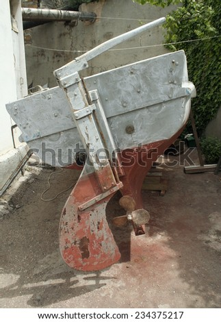 old boat, propeller and rudder - stock photo