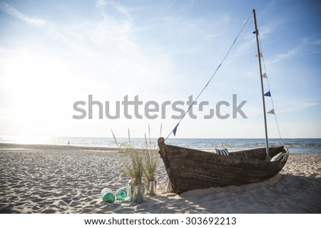 Old boat standing in beach - stock photo