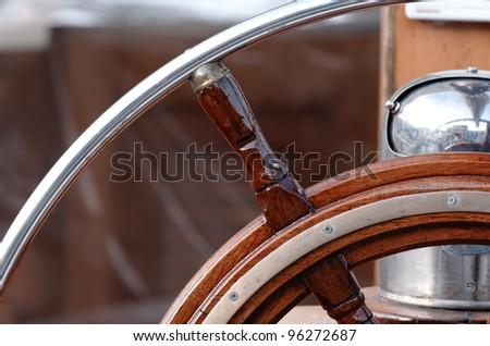 old boat steering wheel - stock photo
