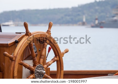 Old boat steering wheel from wood - stock photo