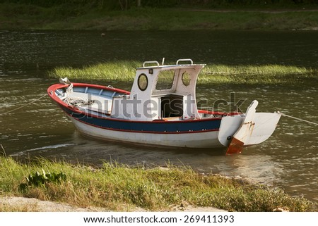 old boats moored on the river bank in Galicia Spain - stock photo