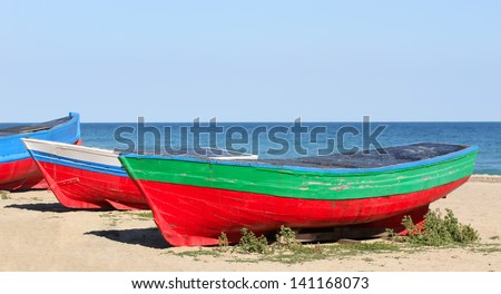 Old boats resting on the beach in Badalona, (Barcelona) Spain. - stock photo