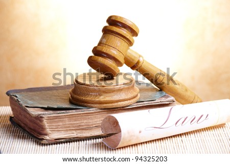 Old book and gavel with old paper with word law - stock photo