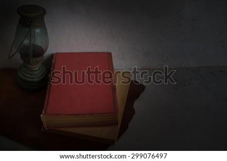 old Book and kerosene lamps - stock photo