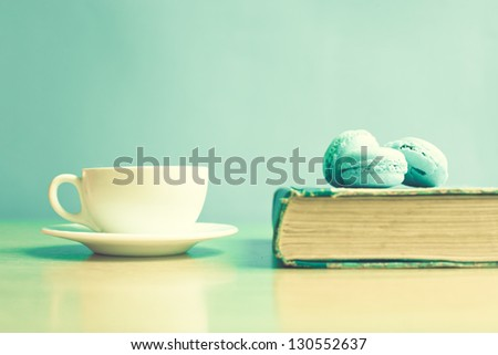 Old book and macaroons - stock photo