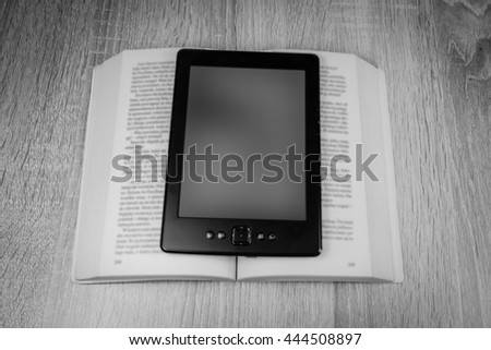 Old book and modern one, black and white photo - stock photo