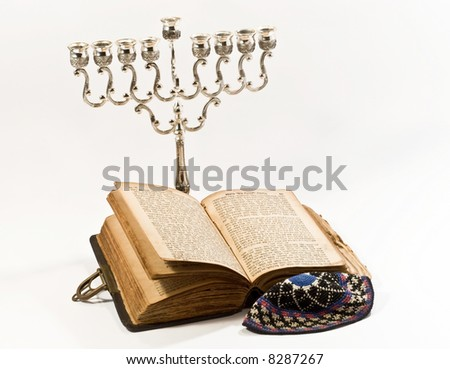 Old book and silver candlestick - stock photo