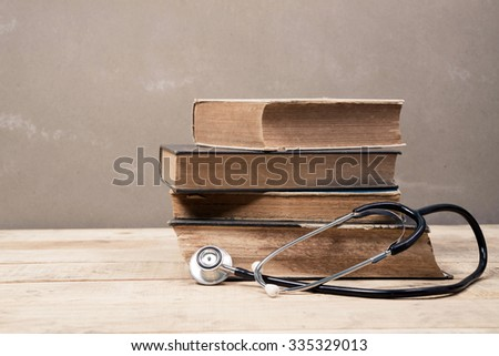 Old Book and Stethoscope - stock photo