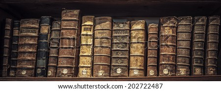 old book in a library - stock photo