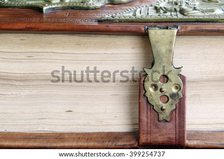 Old book in leather cover with a lock. - stock photo