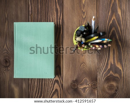 Old book lying on the table. View from above - stock photo