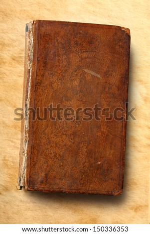 Old book on paper background - stock photo