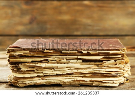 Old book on wooden table - stock photo