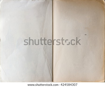 Old book opened to the first page showing blank pages inside. - stock photo
