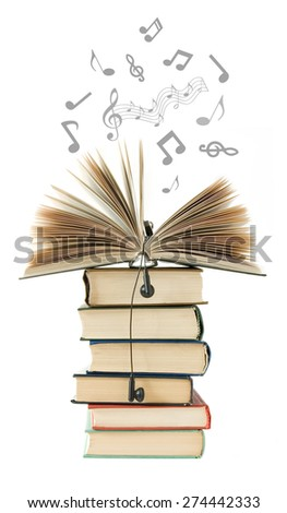 Old book pile and music notes flying away isolated on white background. Audio book concept - stock photo