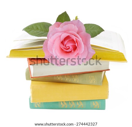 Old book pile with rose isolated on white background. Teacher's day concept - stock photo