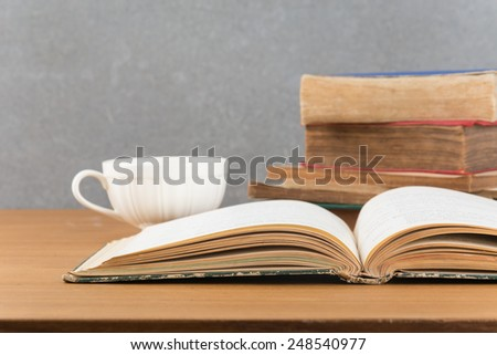 old book with books stack and coffee - stock photo
