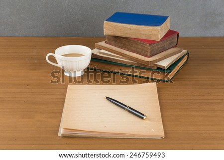 old book with pen and coffee - stock photo