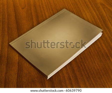 old  book with white cover on wood background. - stock photo