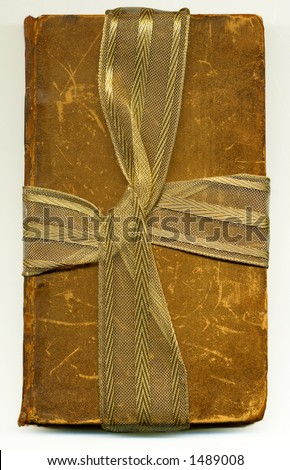 old book wrapped up ribbon 2 - stock photo