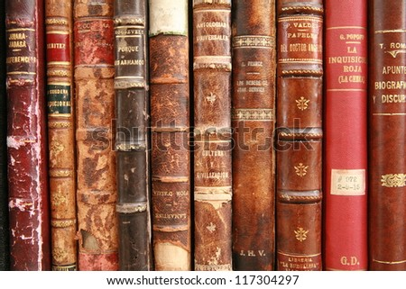 old books at display on a market - stock photo