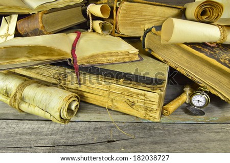 Old books background with pocket watch and copy space - stock photo