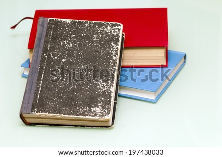 old books on a pile - stock photo