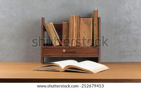 old books on the mini old shelf - stock photo