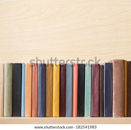 Old books on the shelf. - stock photo