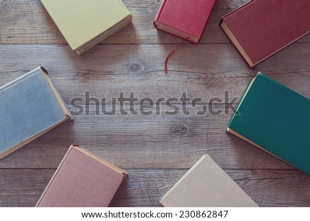 Old books on wooden background. View from above - stock photo