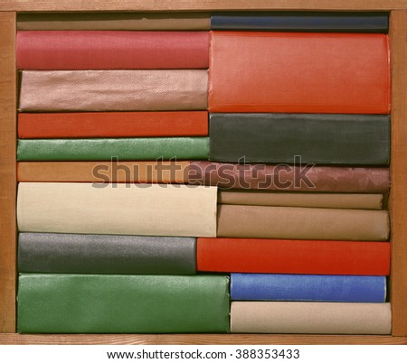 Old books on wooden brown shelf - stock photo